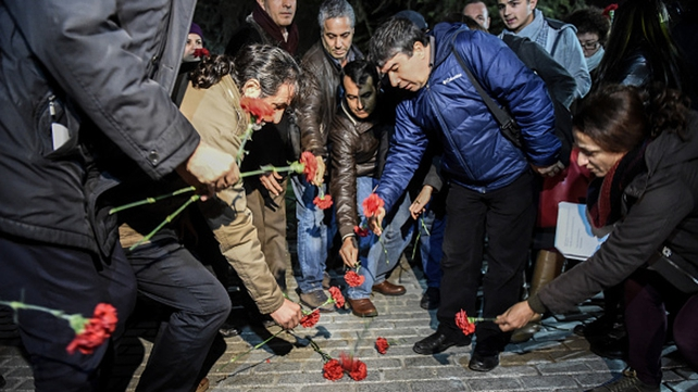 People lay flowers at the scene of the blast in the Sultanahmet district