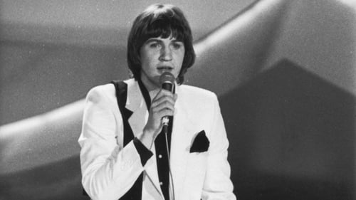 Johnny Logan in his bright white suit