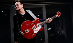 Bono's red Gretsch is up for auction. Fire, three chords, and truth not included