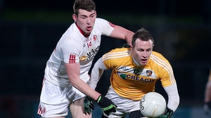 Tyrone's Padraig McNulty with Antrim's Michael McCann