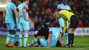 Referee Martin Atkinson stands over an injured Andy Carroll on Tuesday night