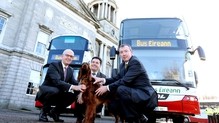 Paschal Donohoe (C) along with NTA Director of PTS Tim Gaston (L),  Bus Éireann CEO Martin Nolan and red setter Teelin at the launch of the new buses