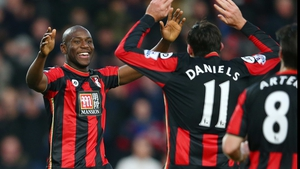 Benik Afobe (L) celebrates scoring Bournemouth's third goal with his team mate Charlie Daniels