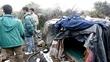 Bulldozer clears makeshift Calais refugee camp