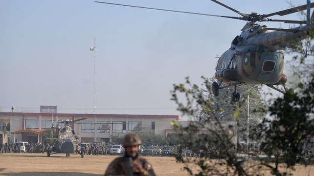 Troops were also flown in by helicopter to assist