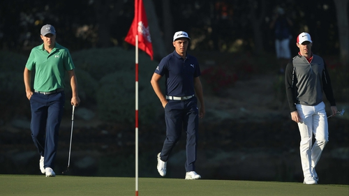 Jordan Spieth and Rickie Fowler on the 12th green with Rory McIlroy
