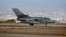 A RAF Tornado returns to a British base in Cyprus following a sortie to Syria