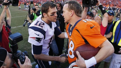 Tom Brady (L) and Peyton Manning after the Broncos' AFC Championship win in 2014