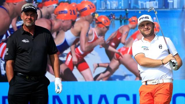 Darren Clarke watches Andy Sullivan's tee shot at the third hole