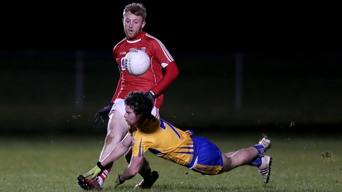 Cork's Killian O'Hanlon gets the ball away under pressure from Cian O'Dea of Clare during Friday's McGrath Cup final