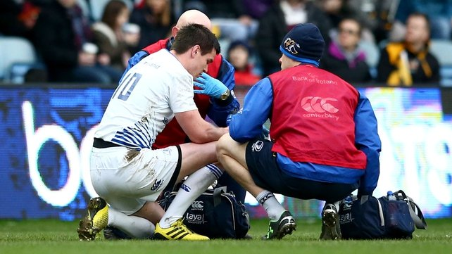 Johnny Sexton gets treatment after a clash of heads