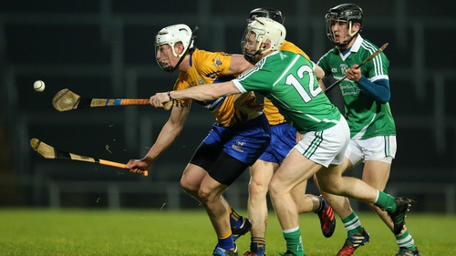 Limerick's Cian Lynch tackles Conor Cleary of Clare
