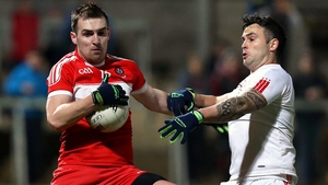 Derry's Ryan Bell and Cathal McCarron of Tyrone
