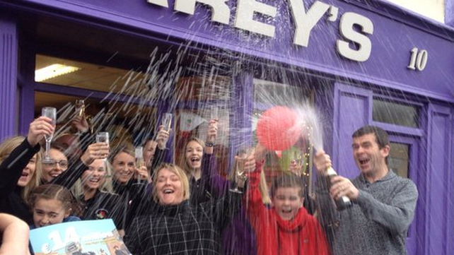 Staff at Carey's Newsagents in Belmullet, Co Mayo, celebrate selling the winning ticket