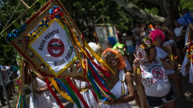 Revellers wearing Greek style costumes call for the prevention of the Zika virus in the first carnival on the streets of Rio de Janeiro yesterday