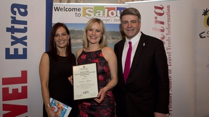 Deirdre Mullins being presented with the Travel Extra Award