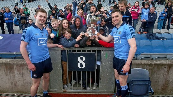 Dublin's Jack McCaffrey and Paddy Andrews celebrate with supporters after winning the Division 1 crown in 2015