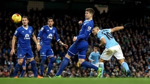 Sergio Aguero heads home the decisive goal at the Etihad
