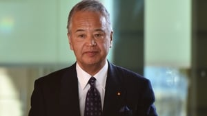 Japan's Economy Minister Akira Amari acknowledged taking money from a construction company executive