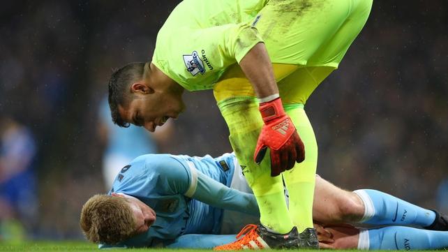 Everton goalkeeper Joel Robles stands over Manchester City's Kevin De Bruyne