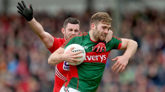 Cork's Noel Galvin challenges Aidan O'Shea of Mayo in last year's Division 1 encounter at Páirc Uí Rinn - a match which the hosts won