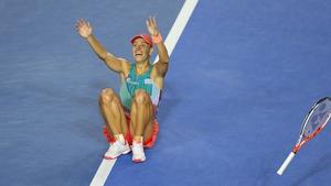 Angelique Kerber drops to the floor after winning the Australian Open in Melbourne