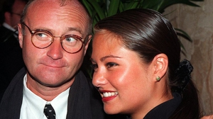 48-years old Phil Collins with his then fianceé Orianne Cevey, aged 27, in 1997.