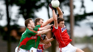 Mark Collins of Cork beats Mayo's Shane Nally and Jason Gibbons to a ball