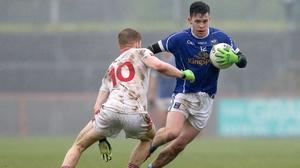 Tyrone's Cathal McShane tackles Cavan's Dara McVeety