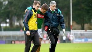 Lee Keegan is helped from he field against Cork