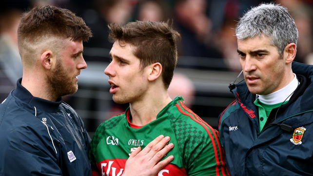 Eoin Cadogan checks on Lee Keegan after the game