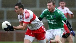 Derry's Cailean O'Boyle and Fermanagh's Aidan Breen