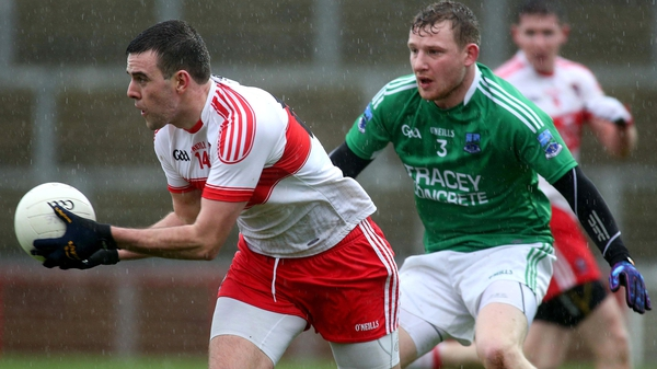 Derry's Cailean O'Boyle and Fermanagh's Aidan Breen