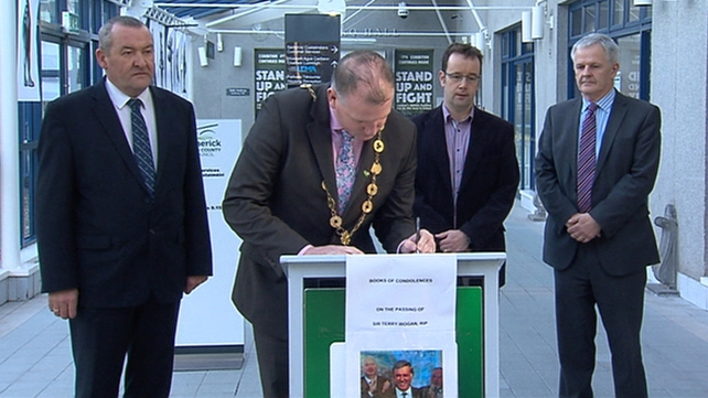 Limerick City Mayor Liam Galvin signs a book of condolence