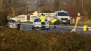 The car collided with a parked Garda patrol car, injuring two gardaí
