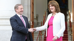 Enda Kenny and Joan Burton on the steps of Government Buildings