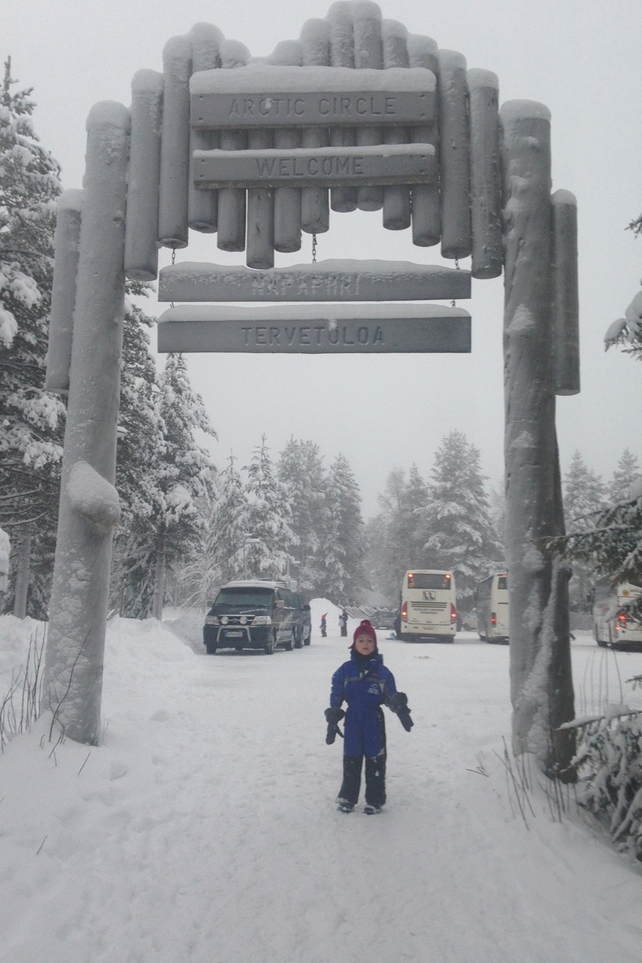 No time to pose at the entrance to the Arctic Circle and Santa Village, just 'C'mon Mum!'