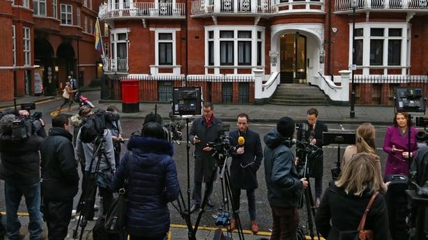 Media gather outside the  Ecuadorian embassy in London
