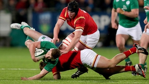 Ireland's John Poland tackled by Harri Millard