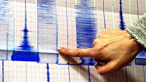 A member of the Seismological Observation Centre points to a graph after an earthquake and aftershocks hit southern Taiwan