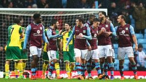 Aston Villa's players celebrate Joleon Lescott's opener