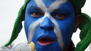 Ready for the battle - A Scotland fan gets in a feed of chips before the game