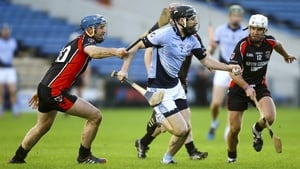 Na Piarsaigh's Cathal King evades Oulart challenges