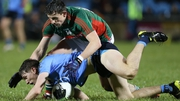 Michael Fitzsimons of Dublin and Jason Doherty of Mayo grapple for possession