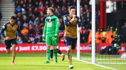 Artur Boruc looks dejected as Mesut Ozil celebrates his goal