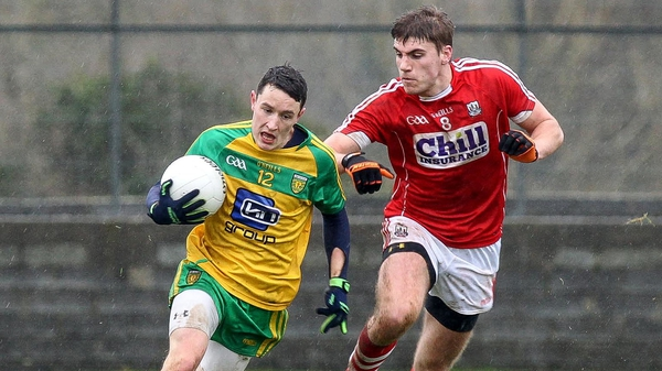 Donegal's Eoin McHugh fends off Ian Maguire of Cork