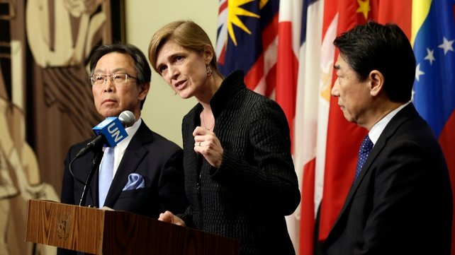 US ambassador to the UN, Samantha Power (C), Japanese ambassador to the UN, Motohide Yoshikawa (L) and South Korean ambassador to the UN , Oh Joon (R) brief the media after their emergency meeting