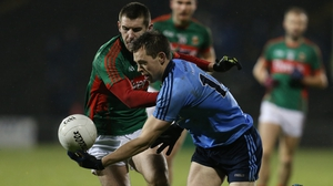 Dean Rock of Dublin spins away from Mayo's Caolan Crowe