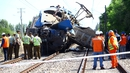 Members of the Chilean authorities work in the place where a train crashed with a car in Talca, Chile