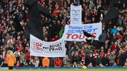Fans in the Kop display banners and black flags in protest to ticket price hikes